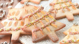 Almond Christmas Biscuits decorated with almonds, icing, sprinkles and silver balls