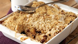 Bramley Apple and Raisin Crumble served in a white dish