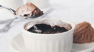 Chocolate Souffles, served in a ramekin with a side of chocolate ice cream