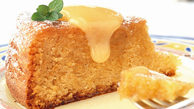 Tunisian Almond and Citrus Cake with Lemon Curd, served with generous amounts of lemon curd