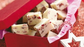 White Chocolate and Cranberry Fudge served ina red box with pink tissue paper