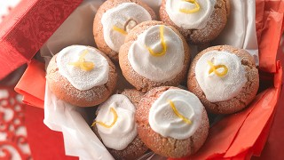 Traditional Lebkuchen Biscuits topped with icing and served in a red box
