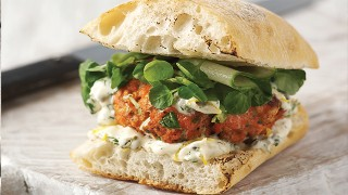 Fresh Salmon Burgers with lemon, caper and dill mayonnaise, served on a toasted ciabatta bun