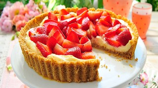 English Strawberry and Mascarpone Tart on a white dish with a slice missing to show the filling