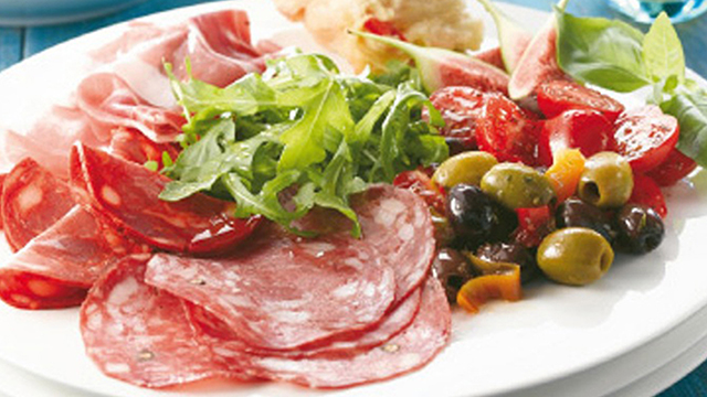 Booths tapas platter with salami, proscuitto, chorizo, green olives, rocket and plum tomatoes