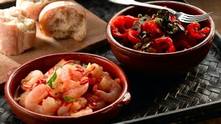 Spanish Red Pepper Salad with garlic and chilli prawns served in bowls with warm bread