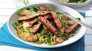 Teriyaki Beef and Rice Noodle Salad served in a white dish
