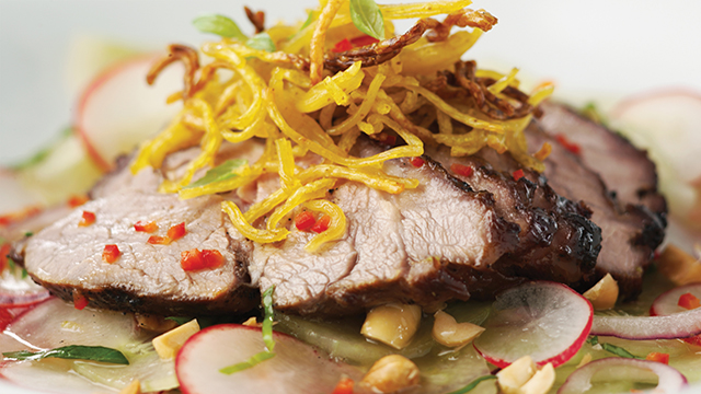 Thai Inspired Lamb Salad with Crispy Noodles served on top of salad with dressing