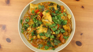 Rafi's Spicebox Do Piyaza Curry Pack with Coley served in a white bowl topped with coriander