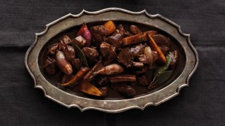 Easty Game Casserole served on a dish on a grey tablecloth