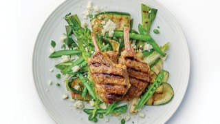 Greek Lamb Chops with Griddled Courgette, Mint and Feta salad served on a white plate