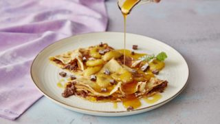 Nutella and Banana Pancakes being drizzled syrup