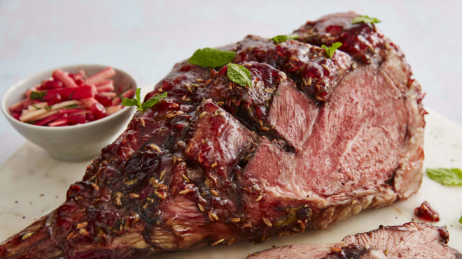 Lamb with Redcurrant and Mint Glaze with a portion sliced off to show the inside of the meat