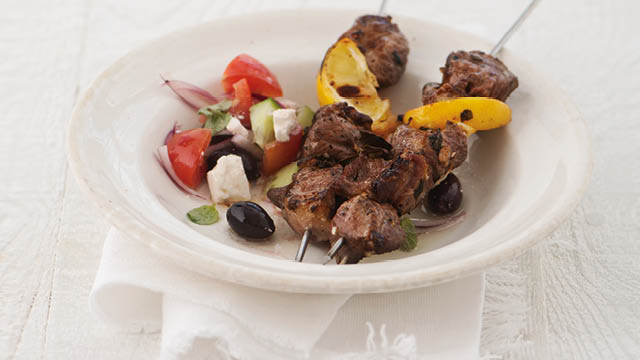 Spiced Saltmarsh Lamb Kebabs with greek salad including tomatoes, feta cheese and black olives