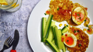 Sweetcorn Fritters with jammie eggs served with cucumber sticks