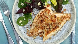 Fish Fillets with blue cheese crumb served with a side salad on a blue plate