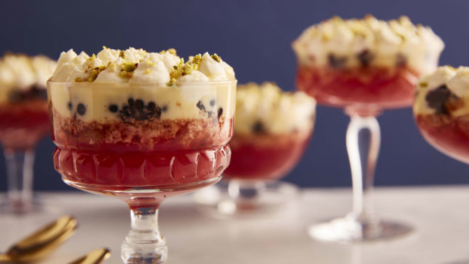 Blackberry and Amaretti Trifles served in glass dishes and topped with pistachio nuts