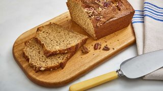 Healthier Banana Bread served on a wooden board and sliced