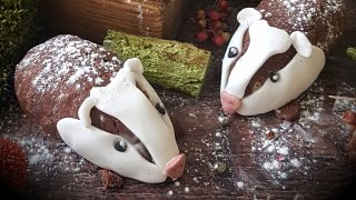 Buttercream Sponge Cake Bertie Badgers served on a wooden board and sprinkled with icing sugar