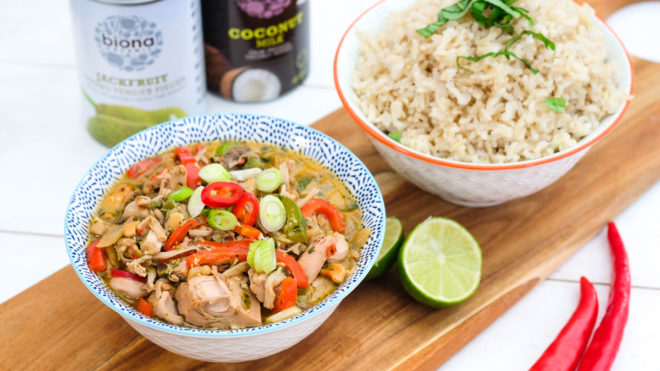 Biona's Organic Vegan Thai Jackfruit Curry served in a blue bowl with a bowl of rice