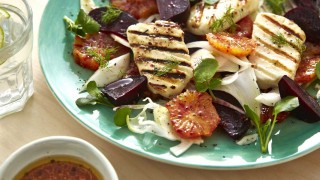 Blood Orange, Beetroot and Griddled Halloumi Salad served on a blue plate and sprinkled with parsley and dill