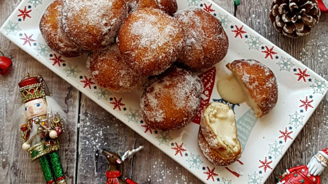 ~Gingerbread Doughnuts dusted with sugar served on a festive plate