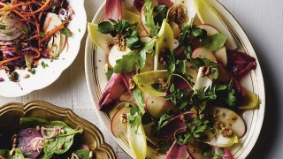 Chicory, Apple and Walnut Salad served on a white dish topped with walnuts