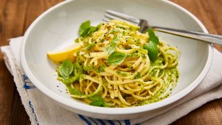 Vegan Lemon and Broccoli Pesto served over pasta in a white bowl