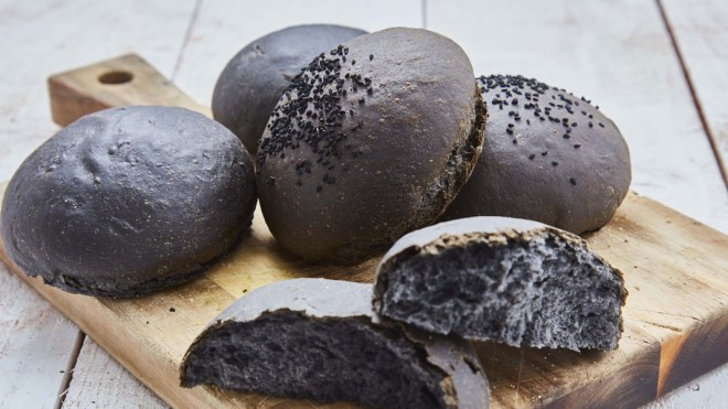Charcoal Brioche Buns served on a wooden board