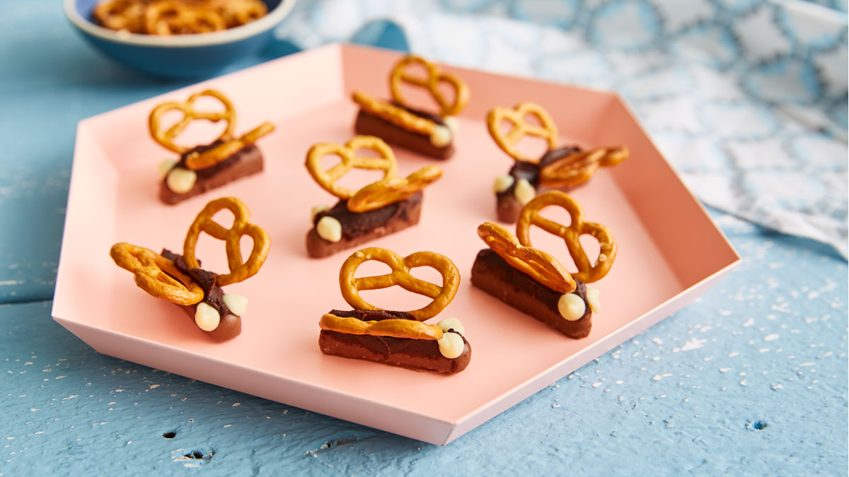 Easy Chocolate Butterflies served on a pink hexagonal plate