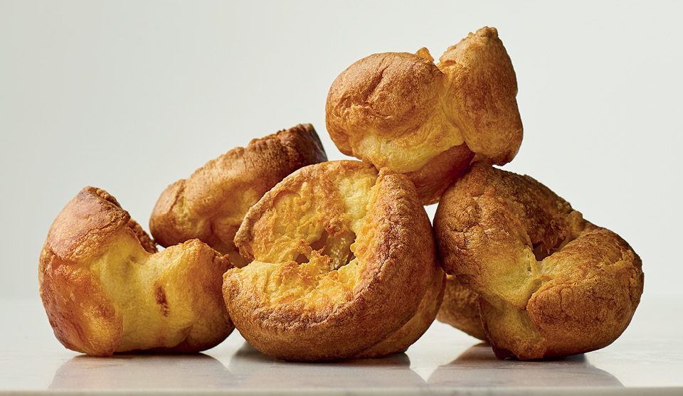 Perfect Yorkshire Puds stacked on top of one another
