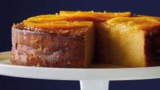 Gluten-Free Zesty Orange Polenta Cake served on a white dish with a slice removed