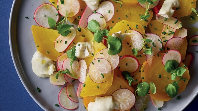 Roasted Golden Beetroot, Watercress and Goats Cheese Salad served on a grey plate and topped with chives