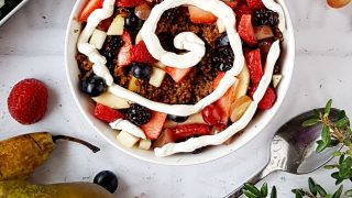 Apple and Cinnamon Baked Oatmeal served in a bowl and topped with berries and plain yoghurt