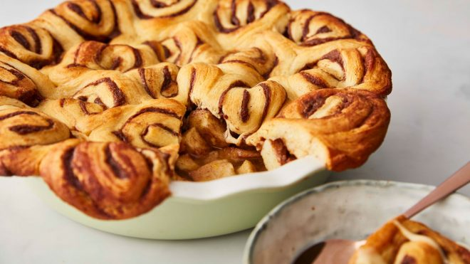 Apple and Cinnamon Swirl Pie served in a baking dish, with a portion removed to see the filling