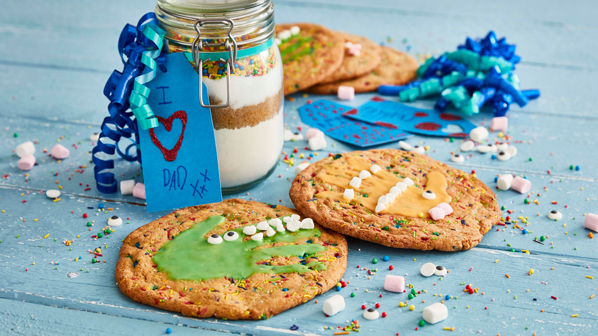 Decorated cookies in front of a jar of dry ingredients