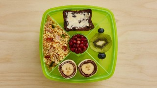 Couscous Salad Lunchbox with various fruit snacks