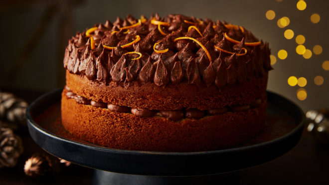 Orange Jaffa Chocolate Drizzle Cake served on a black cake dish