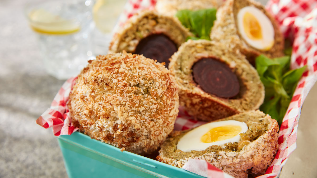 Falafel Scotch Eggs served sliced to show the fillings
