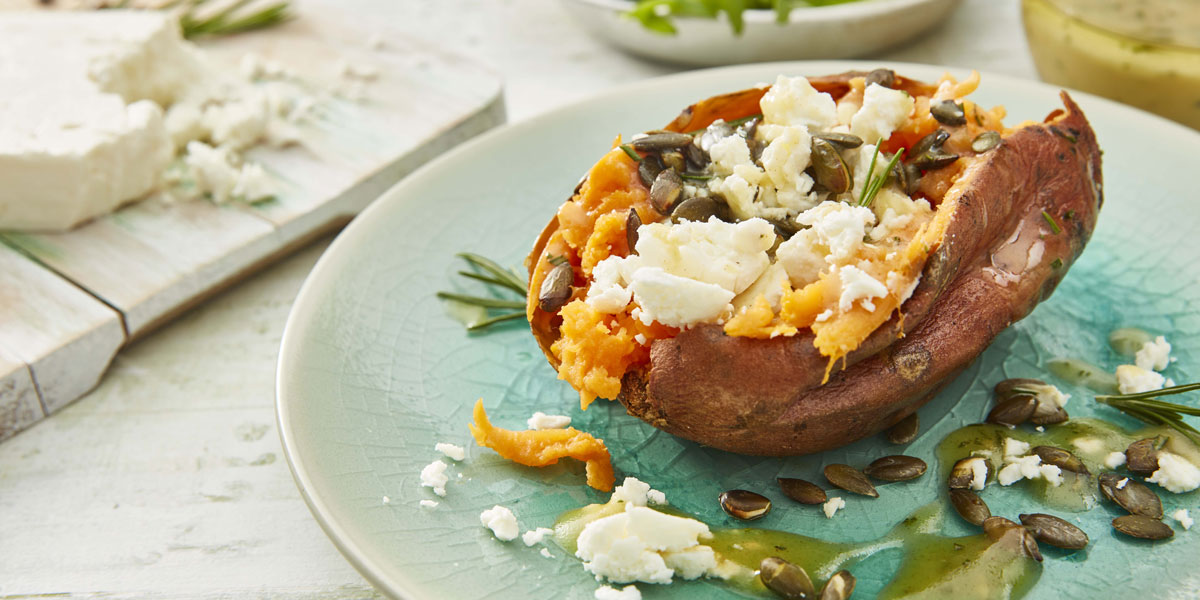 Baked Sweet Potato with Feta, Rosemary and Honey, drizzled with olive oil and sprinkled with toasted pumpkin seeds