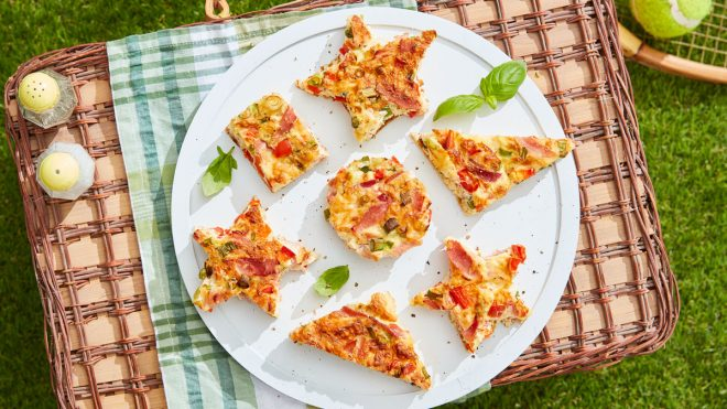 Traybake Frittata Picnic Bites served in various shapes on top of a picnic basket