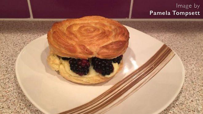 Lemon and Blackberry Paris-Brest served on a plate