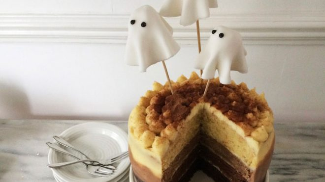 Malted Ombre Ghost Cake served on a white dish with a slice removed to see the ombre effect inside
