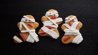 Gingerbread Zombie Mummies served on a black background