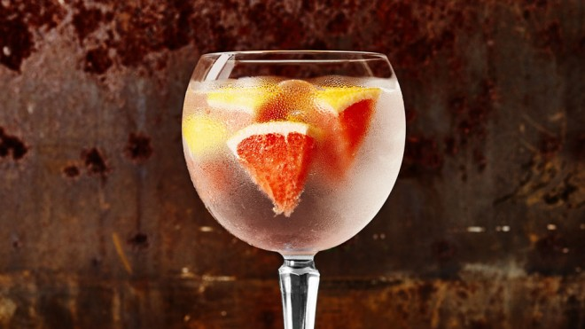 Ginspiration - Batch's Burnley Negroni served in a glass with ice and sliced blood orange