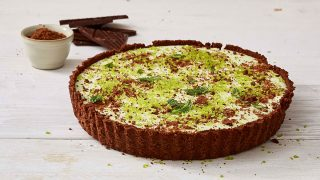 Festive Grasshopper Pie served on a white wooden table