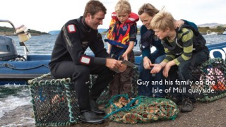 Guy and his family on the Isle of Mull quayside