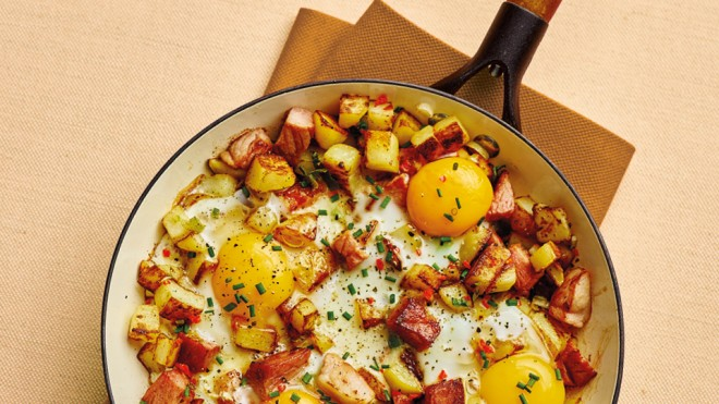 Crusty Ham and Potato Hash topped with chives, served in a pan