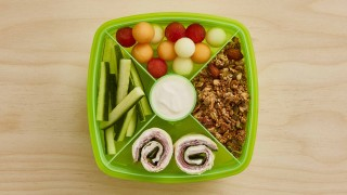 Ham and Cheese Wrap Lunchbox with various fruits and vegetables