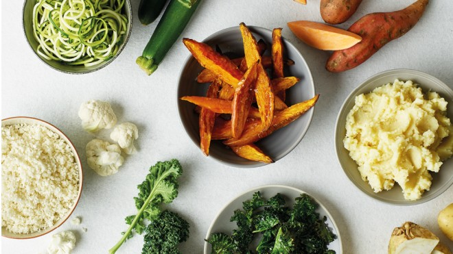 Cauliflower Rice, Courgette Spaghetti, Sweet Potato Wedges, Kale Crisps and Celeriac Mash served in separate bowls